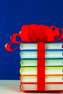 Stack of colorful books tied up with ribbon
