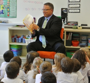 Mr. Logan reads to grade 1