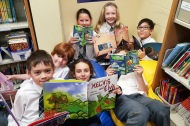 Grade 4 students reading Silver Birch Express books.